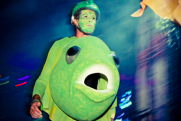 Colorfully dressed dancers with fish costumes surrounded the stage at Benny Bennasi's set