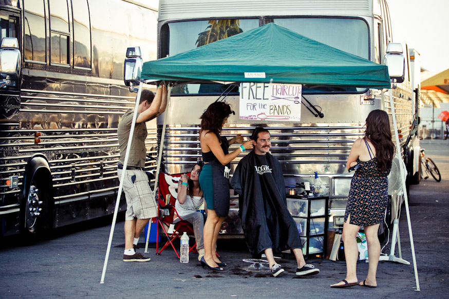 With 43 stops in the span of two months, backstage at the Warped Tour becomes a community of caterers, rest areas, and even a free haircut stand for band members