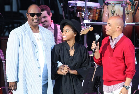 (L-R) Musician Stevie Wonder, singer Janelle Monae and composer Rickey Minor onstage at The Hollywood Bowl on July 24, 2011 in Los Angeles, California.