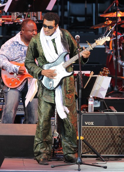 """Musician Omara """"Bombino"""" Moctar performs onstage at The Hollywood Bowl on July 24, 2011 in Los Angeles, California."""