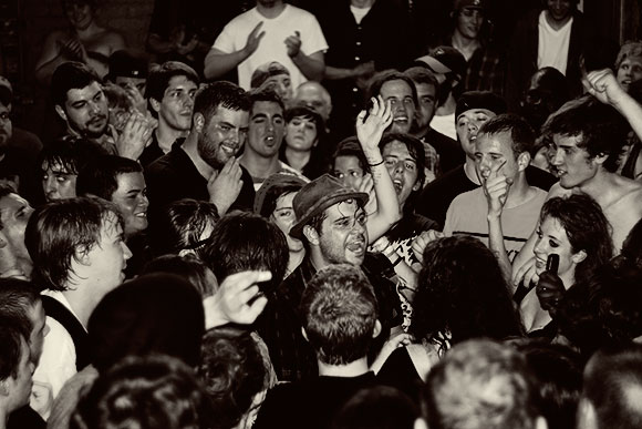 Mischief Brew Frontman Erik Petersen joins the crowd at the May 1 record release party The Stone Operation