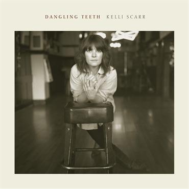 Kelli-Scarr-Dangling-Teeth