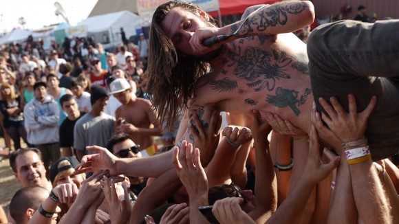While She Sleeps lead vocalist Lawrence Taylor crowd surfs amongst fans.