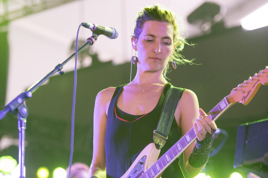 Emily Kokal of the all female band Warpaint fighting the winds in the Mojave tent on Saturday.