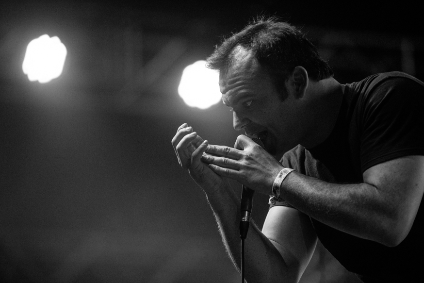 Samuel T. Herring passionately singing with Future Islands in the Gobi tent.