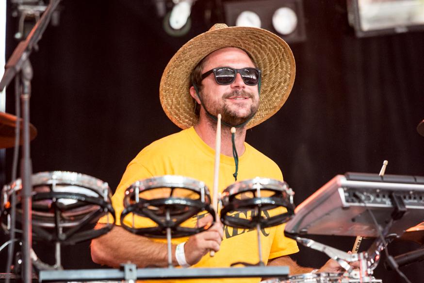 Poolside's drummer sheilding his eyes from the desert sun.