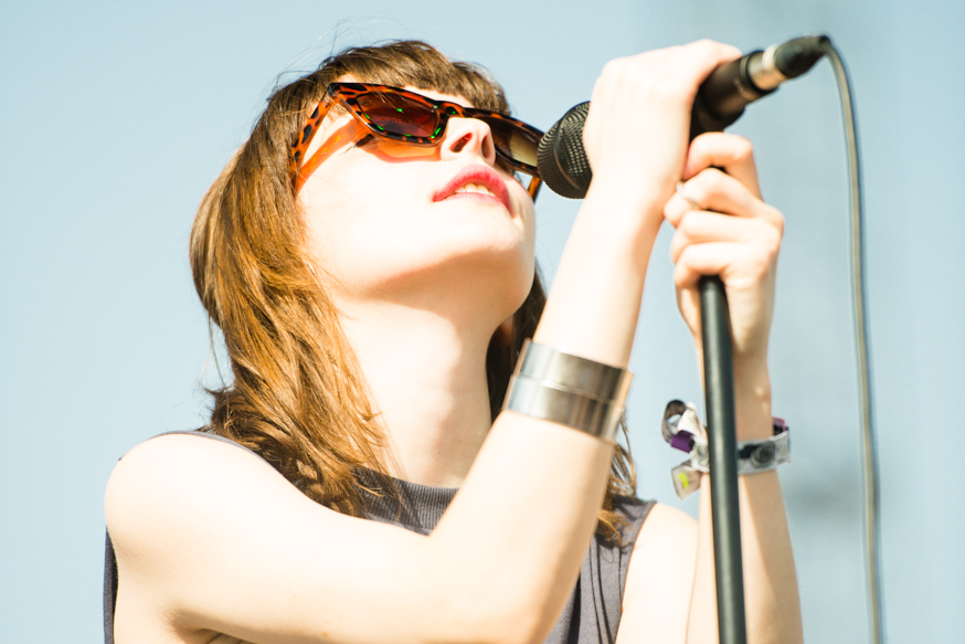 Lauren Mayberry of Scottish band Chvrches performing in the mid afternoon heat on Saturday.
