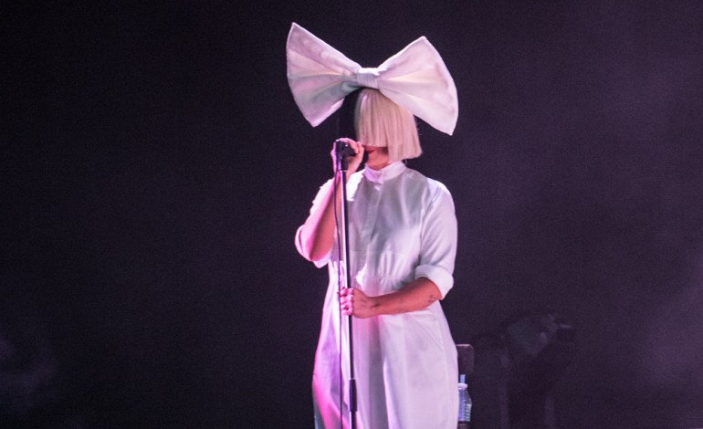 "Sia Teams Up with David Guetta for Another Electro-Pop Anthem ""Flames"""